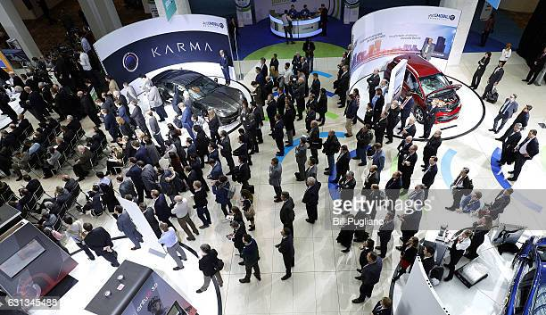 People listen to Carlos Ghosn Nissan Motor Corporation Chairman and CEO speak at the 2017 North American International Auto Show on January 9 2017 in...