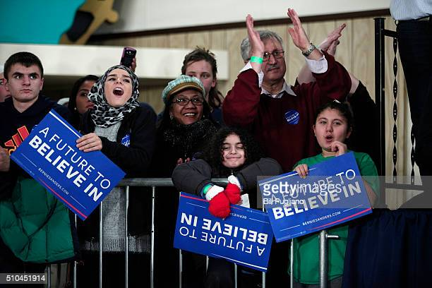 People listen to Democratic presidential candidate US Sen Bernie Sanders speak at a campaign rally at United Auto Workers Union Local 600 February 15...