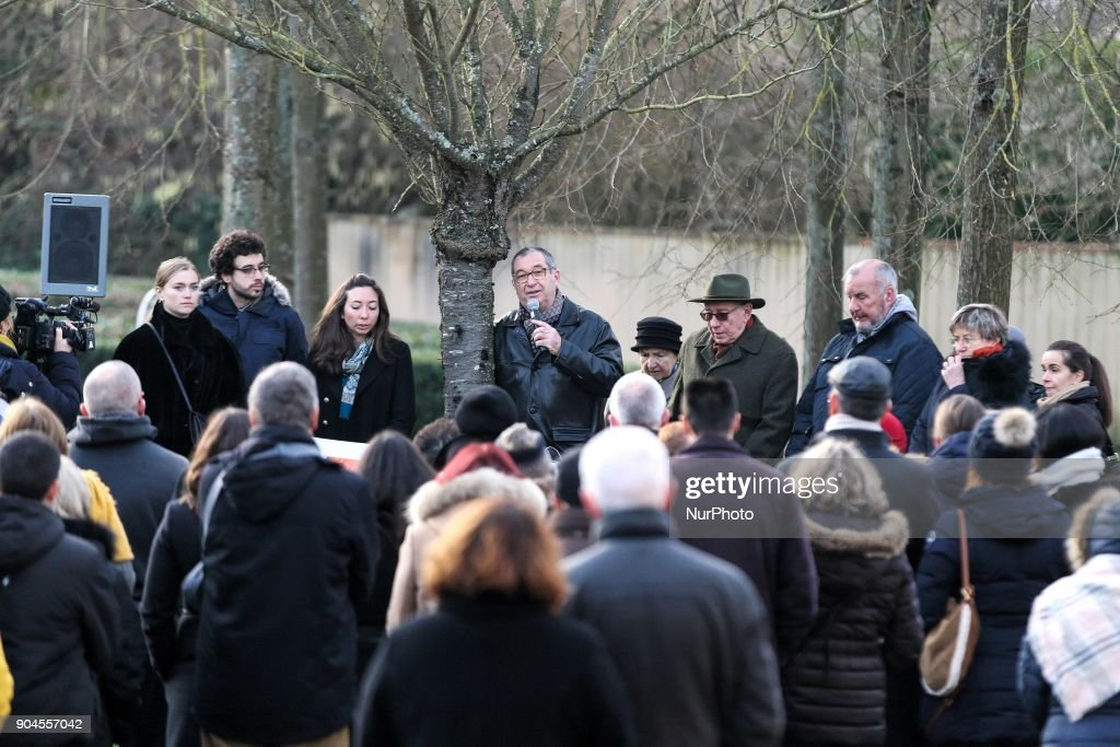 People listen to Eric Mouzin (C), the father of Estelle Mouzin, during a silent march in memory of his daughter, on January 13, 2018 in Guermantes, near Paris, fifteen years after the disappearance of the nine-year old girl. Estelle Mouzin disappeared on January 9, 2003 in Guermantes village some 26 kilometers from Paris.