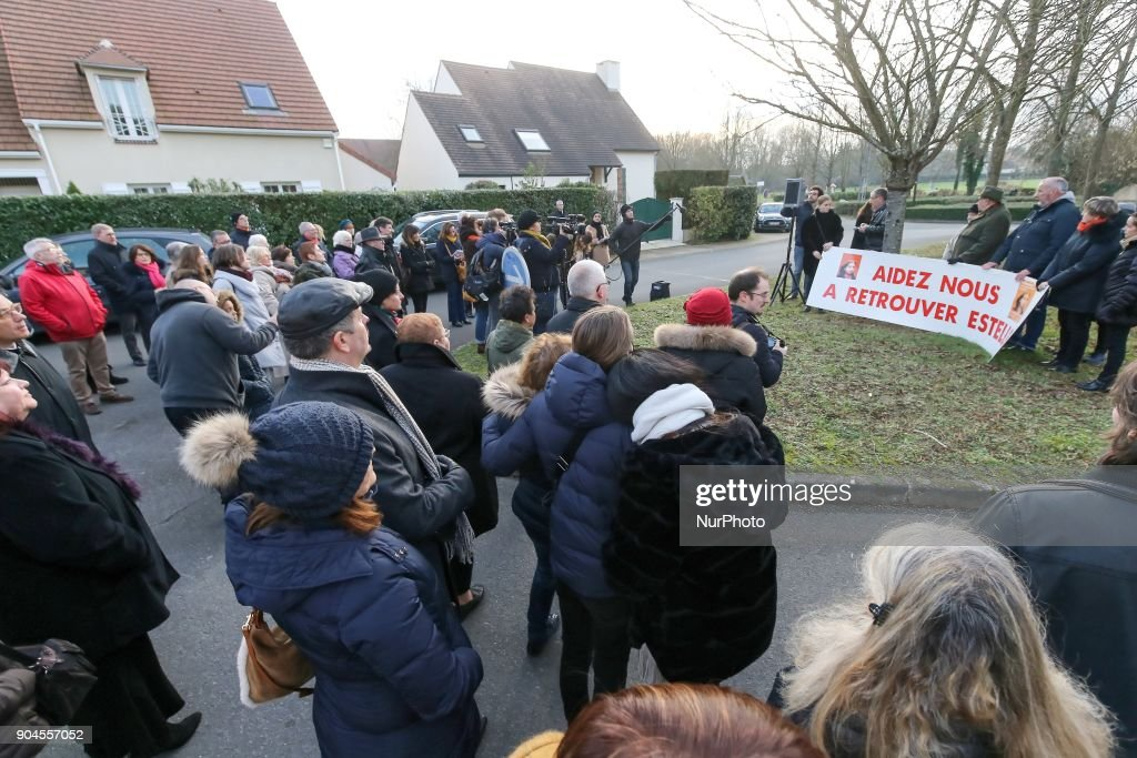People listen to Eric Mouzin, the father of Estelle Mouzin, during a silent march in memory of his daughter, on January 13, 2018 in Guermantes, near Paris, fifteen years after the disappearance of the nine-year old girl. Estelle Mouzin disappeared on January 9, 2003 in Guermantes village some 26 kilometers from Paris.