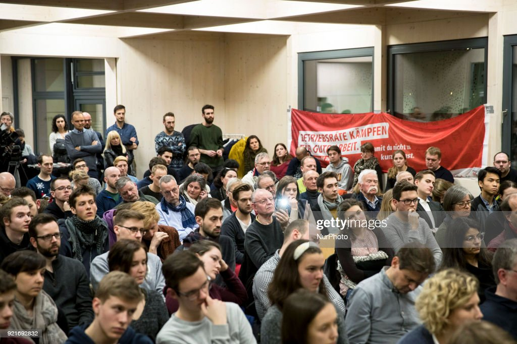 People listen to Jusos Chairman Kevin Kuehnert speaking during a Nogroko Tour Event in Berlin, Germany on February 20, 2017.