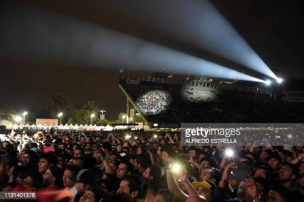 People listen to metal band Korn during the second day of the 'Vive Latino' music festival in Mexico City on March 17 2019