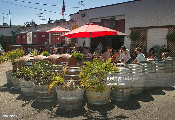 People listen to music in the outdoor patio at Oreana Winery in The Funk Zone on May 21 in Santa Barbara California Now home to dozens of new...