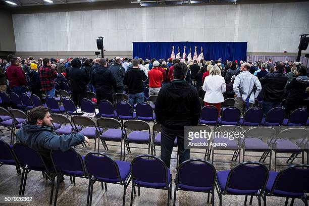 People listen to Republican Presidential Candidate Donald Trump speaking during a campaign rally in Waterloo Iowa USA on February 1 2016 Today the...