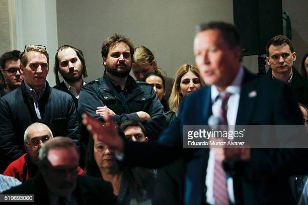 People listen to Republican presidential candidate Governor John Kasich while he speaks at a rally on April 7 2016 in New York City Kasich only has...