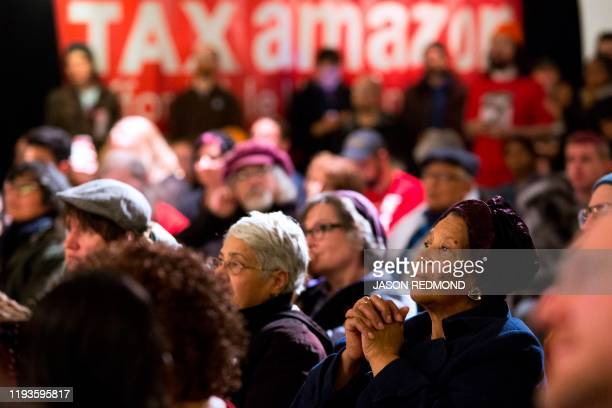 People listen to speakers during a Tax Amazon 2020 Kickoff event and inauguration for Seattle City Councilmember Kshama Sawant in Seattle Washington...