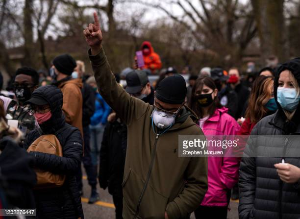 People listen to speakers during a vigil for Daunte Wright on April 12, 2021 in Brooklyn Center, Minnesota. Wright was shot and killed yesterday by...