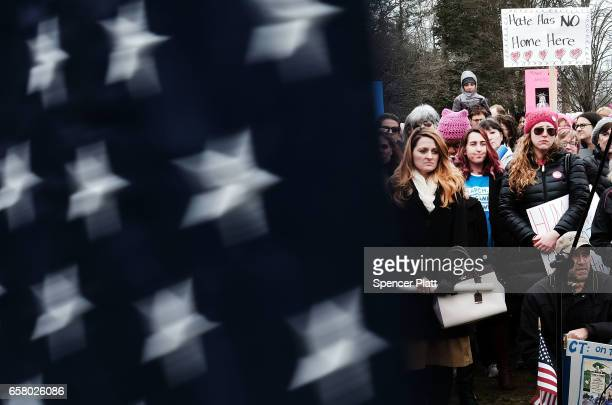 People listen to speakers during an afternoon rally and march to protest against the policies and presidency of Donald Trump on March 26 2017 in...