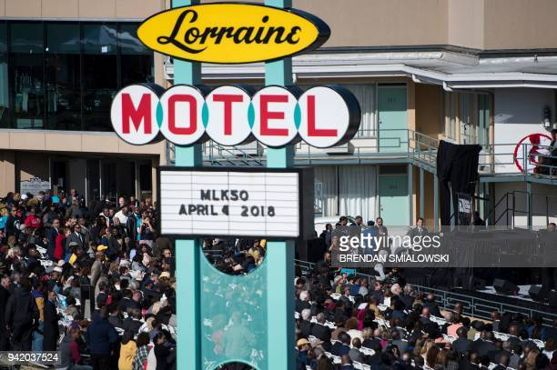 People listen to speakers during an event at the Lorraine Motel commemorating the 50th anniversary of the assassination of Martin Luther King Jr...
