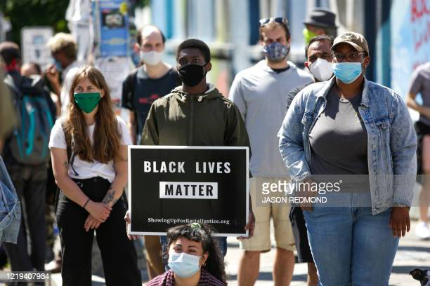 People listen to speakers in the newly created Capitol Hill Autonomous Zone in Seattle Washington on June 11 2020 The area surrounding the East...