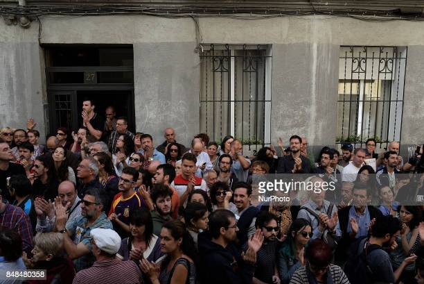 People listen to speeches during the act in support to the referendum of the 1O in Catalonia in Madrid Spain on September 17 2017