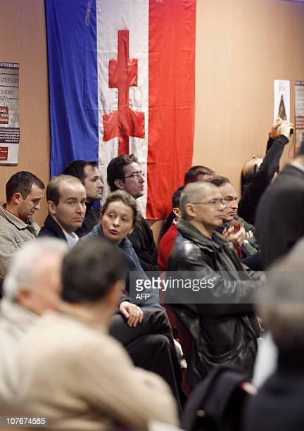 """People listen to speeches on December 18 in Paris, during the """"Assises contre l'islamisation de l'Europe"""" organised by far-right organization French..."""