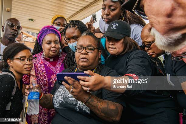 People listen together during the sentencing of former Minneapolis police officer Derek Chauvin on June 25, 2021 in Minneapolis, Minnesota. Chauvin...