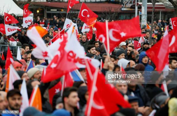 People listen Turkey's Prime Minister and the leader of the Turkey's ruling Justice and Development Party Binali Yildirim's speech during a rally...