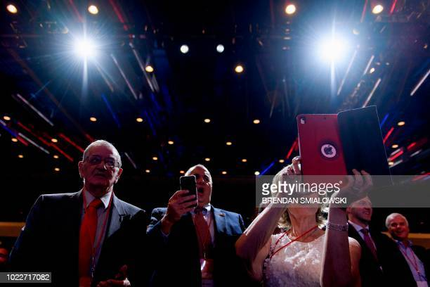 People listen while US President Donald Trump speaks during the Ohio Republican Party State Dinner at the Greater Columbus Convention Center August...