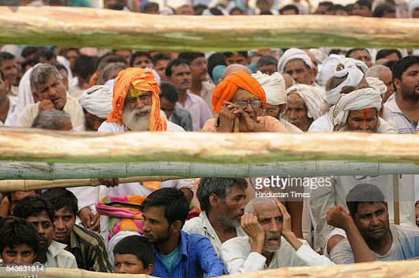 People listening to the speech by Chief Minister of Bihar Nitish Kumar who addressed a rally in which he lambasted on the central and state...