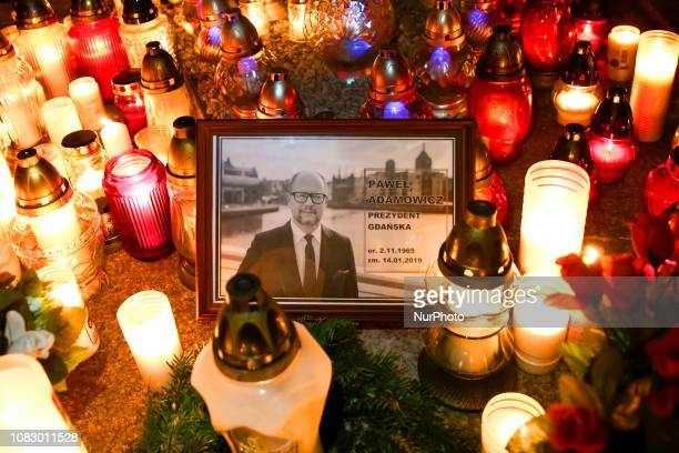 People lit candle during a march throught the center of Warsaw Poland on January 14 2019 in commemoration of Pawel Adamowicz Mayor of Gdansk who was...