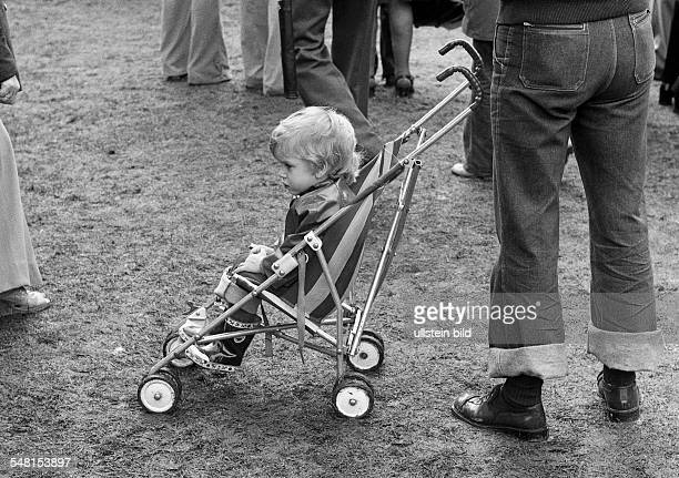 people little boy in a buggy aged 2 to 3 years