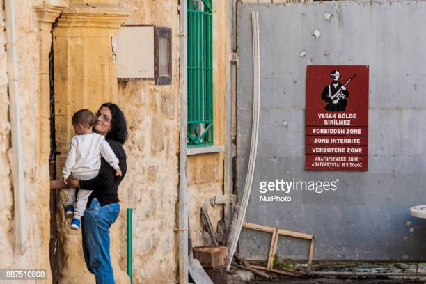 People living close to the wall that separates the turkish and the cypriot side of Nikosia city, Cyprus, on 3 December 2017. Wall is signed with...