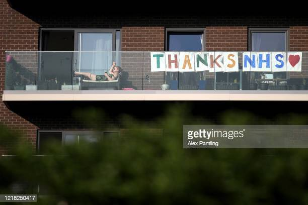 People living in a block of flats show a message hanging from their balcony thanking the NHS at Queen Elizabeth Olympic Park on April 11, 2020 in...