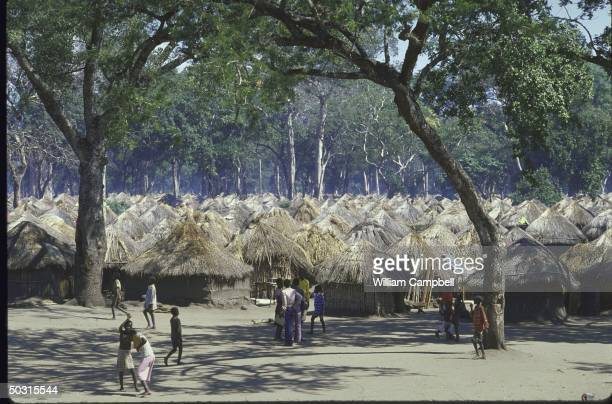 People living in huts at the Casa Banana Refugee Center for the Starving Sick in Sofala Province