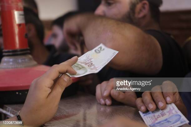 People living in the Syria's northwest, begin to use Turkish lira to maintain their purchasing power amid steep fall in value of Syrian pound against...