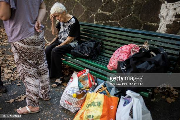 People living near the Morandi motorway bridge wait for their evacuation two days after a section collapsed in Genoa on August 16 2018 A vast span of...