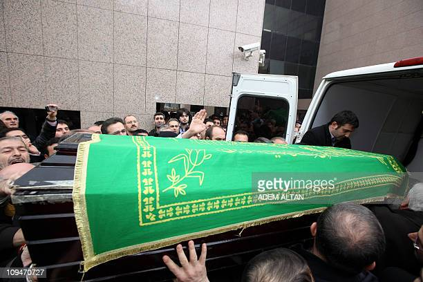 People load the coffin of Necmettin Erbakan the mentor of political Islam in secular Turkey and its first Islamist Prime Minister into a van in...