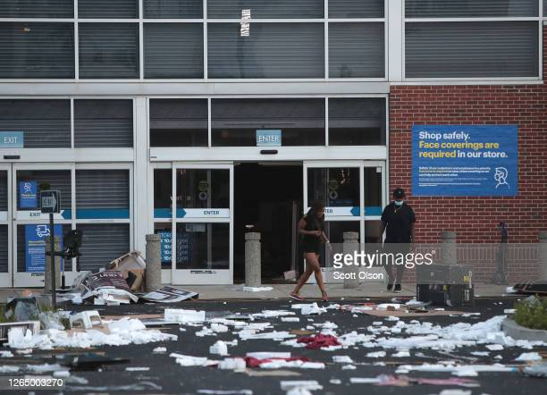 People load walk out of a looted Best Buy store after parts of the city had widespread looting and vandalism on August 10 2020 in Chicago Illinois...