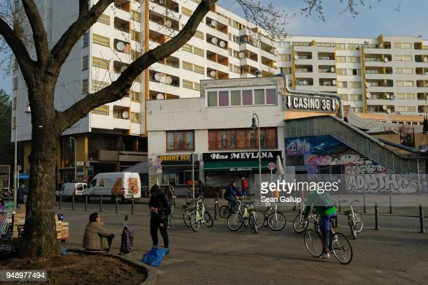 People loiter at Kottbuser Tor in an immigrantheavy part of Kreuzberg district on April 17 2018 in Berlin Germany The intersection is a busy area and...