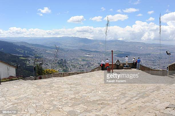 People look at a city view from Monserrate Hill Bogota is located on the west of the Savannah of Bogota 2640 meters above sea level Although it is...