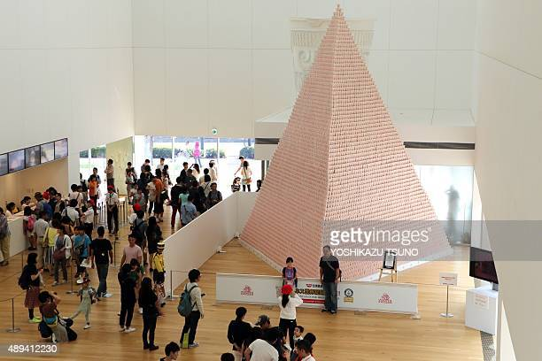 People look at a display of instant noodles pyramid measuring 74m tall and stacked with 57155 of Cup Noodles at the museum in Yokohama suburban Tokyo...