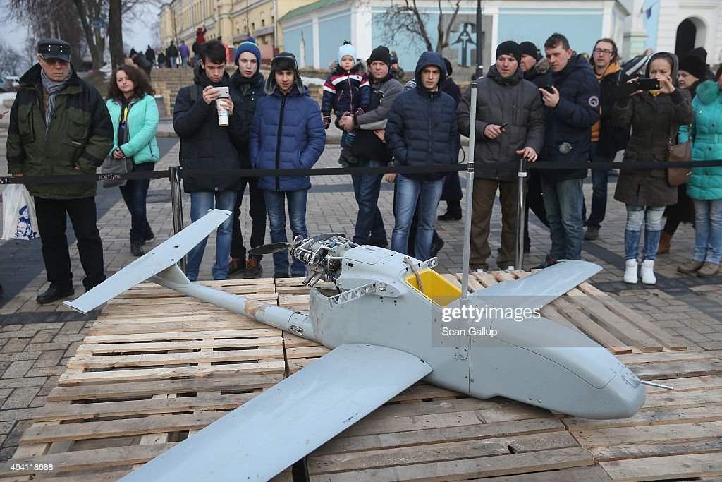 People look at a drone that is part of an exhibition of weapons, documents and other materials the Ukrainian government claims it recovered in eastern Ukraine and prove direct Russian involvement in the fighting between Ukrainian troops and pro-Russian separatists on February 22, 2015 in Kiev, Ukraine. Russia has denied sending heavy weaponry to the separatists, admitting only that Russian volunteers are participating in the fighting.