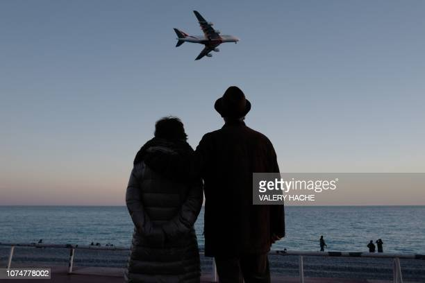 People look at a Emirates A380 airbus landing on the French riviera city of Nice on December 25 2018