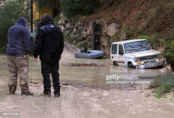 People look at a flood in SainteAgnès southeastern France on January 18 2014 Many roads have been cut in the AlpesMaritimes due to landslides floods...