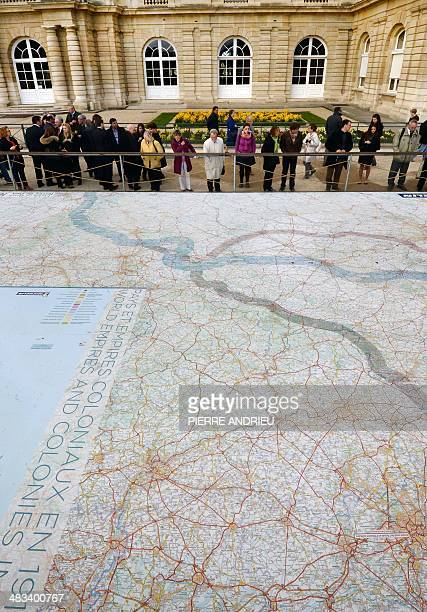 People look at a giant map showing the World War I battlefield set in the Jardins du Luxembourg as part of the exhibition Fields of Battle 1418 on...