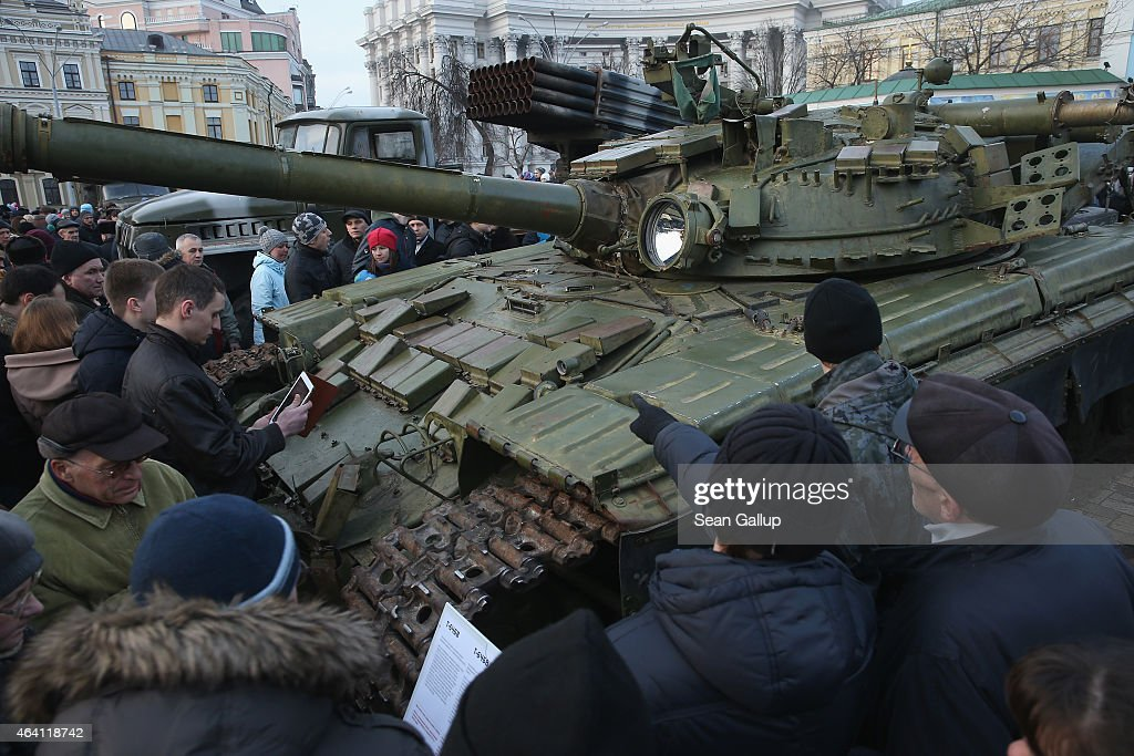 People look at a heavy tank that is part of an exhibition of weapons, drones, documents and other materials the Ukrainian government claims it recovered in eastern Ukraine and prove direct Russian involvement in the fighting between Ukrainian troops and pro-Russian separatists on February 22, 2015 in Kiev, Ukraine. Russia has denied sending heavy weaponry to the separatists, admitting only that Russian volunteers are participating in the fighting.