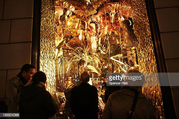 People look at a holiday window display at the Bergdorf Goodman store along 5th Avenue on December 8, 2011 in New York City. Most of New York City's...