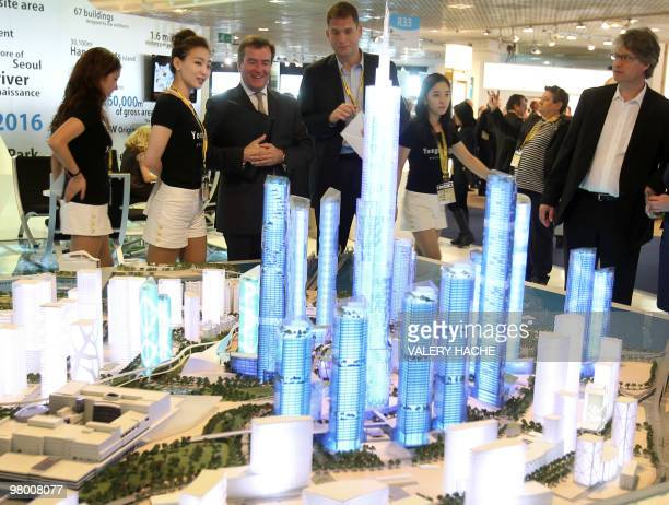 People look at a mockup of the Youngsan International Business District Korean architectural project at a stand during the 21st edition of the...