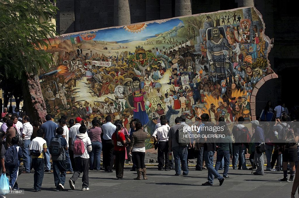 People Look At A Mural In Guadalajara Mexico On November 24 2010