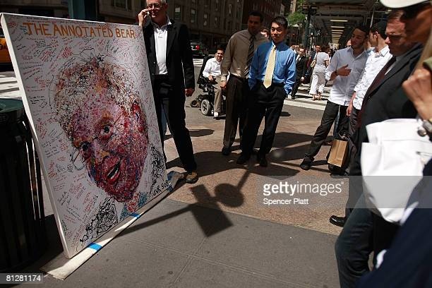 People look at a painted portrait of Bear Stearns CEO James Cayne created by New York artist Geoffrey Raymond on which people and Bear Stearns...