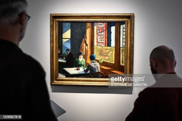 People look at a painting by US artist Edward Hopper named Chop Suey that is part of the Barney A Ebsworth Collection during a presentation of the...