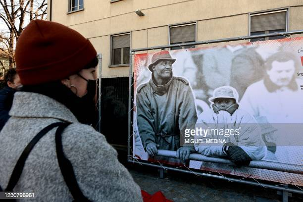 People look at a photo exposition showing a boy Kobe and his father Joe Bryant during the inauguration ceremony of a square named after late Los...