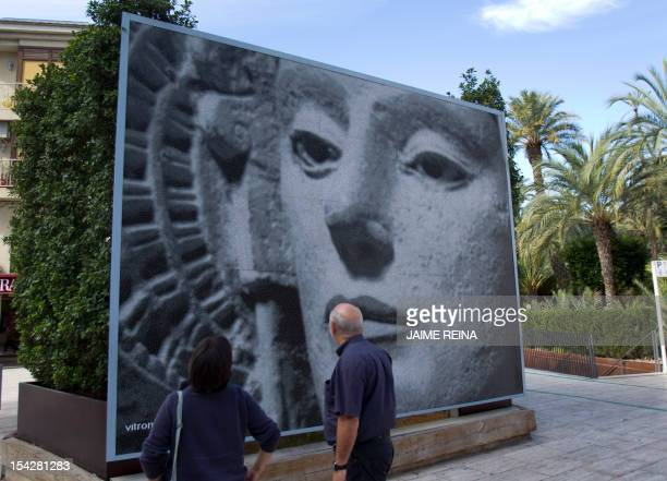 People look at a picture depecting the stone bust of the Lady of Elche in Elche southeast Spain on October 17 AFP PHOTO/ Jaime REINA