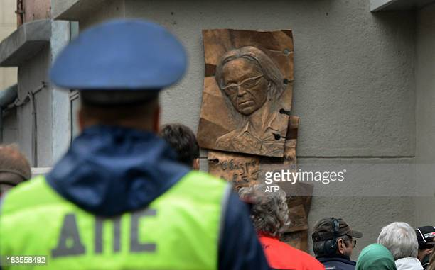 People look at a plaque commemorating slain antiKremlin reporter Anna Politkovskaya in Moscow on October 7 shortly after it was unveiled at the...