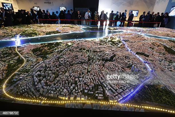 People look at a scale model of Istanbul at the Palais des Festivals on March 10 2015 in Cannes southeastern France during the MIPIM an international...