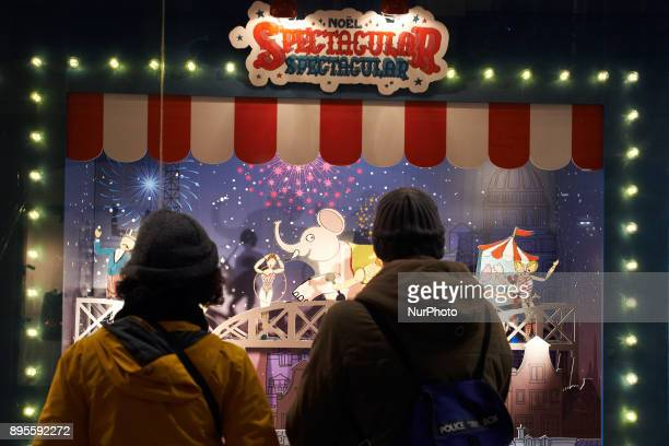 People look at a shop adorned for Christmas A Christmas market is placed on the main square of Toulouse the Capitole People come to buy a hot wine or...