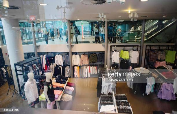 People look at a shop at the flooded basement of a shopping mall on May 29 2018 in Wuppertal western Germany after a storm swept over the region...