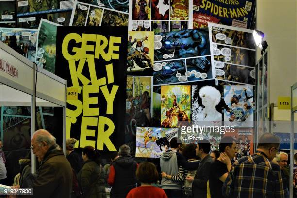 People look at a stand of comic books during the 12th International Ankara Book Fair in Ankara Turkey on February 17 2018