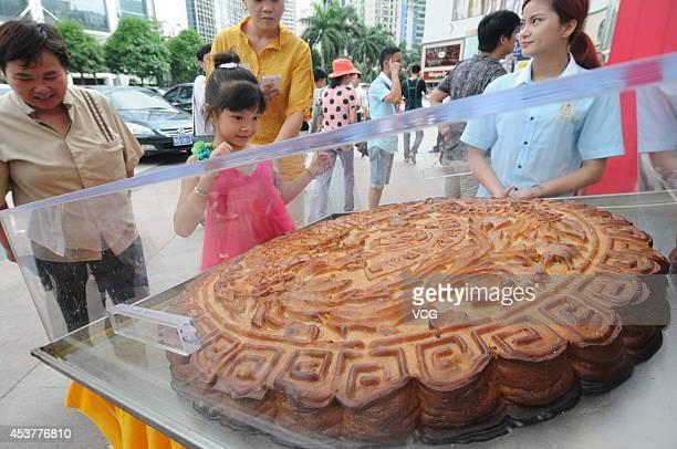People look at an 84 kg mooncake on August 16 2014 in Nanning Guangxi Zhuang Autonomous Region of China